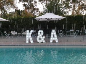 K & A initials by the pool